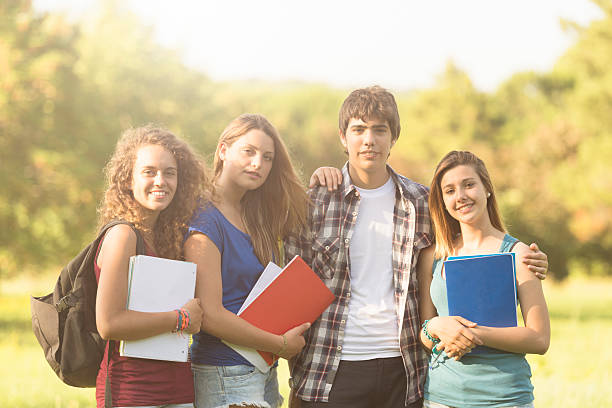 Group of college student outdoors stock photo