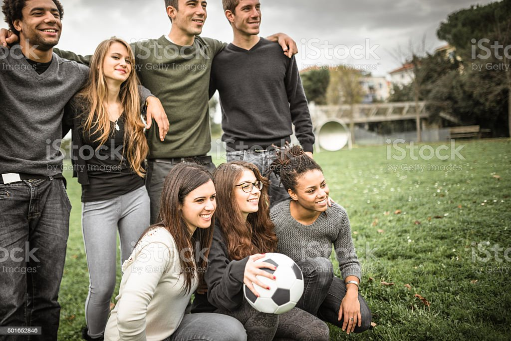 Group of college student posing after the match stock photo