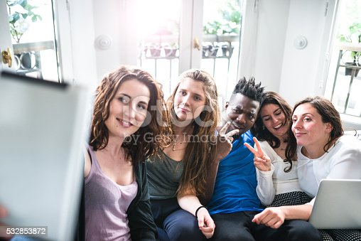 861023492istockphoto Group of college student take a selfie on the apartment 532853872