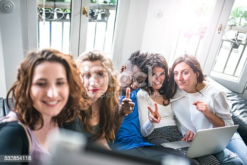 861023492istockphoto Group of college student take a selfie on the apartment 532854118
