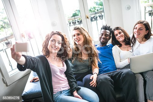 861023492istockphoto Group of college student take a selfie on the apartment 532854276