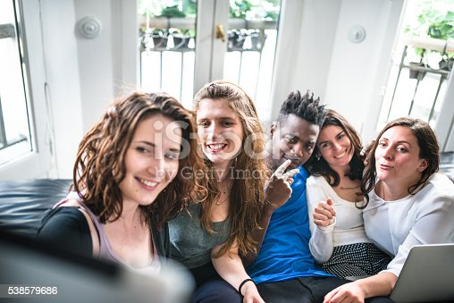 861023492istockphoto Group of college student take a selfie on the apartment 538579686