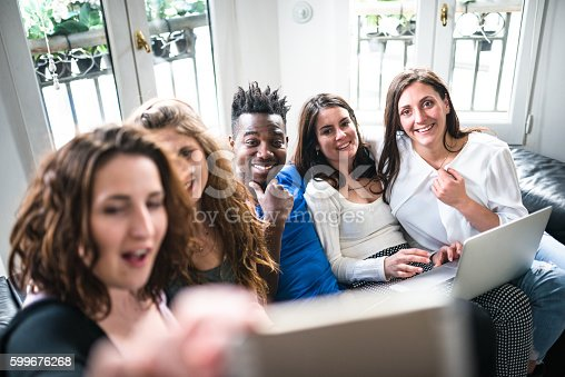 861023492istockphoto Group of college student take a selfie on the apartment 599676268