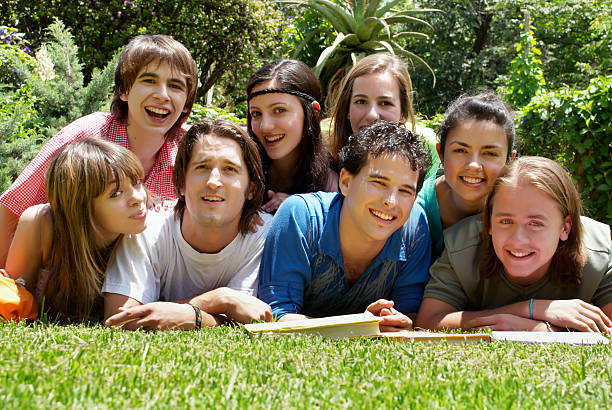 group of college students outdoors stock photo