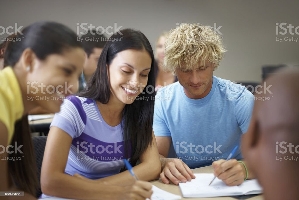 Group of college students studying together in classroom royalty-free stock photo