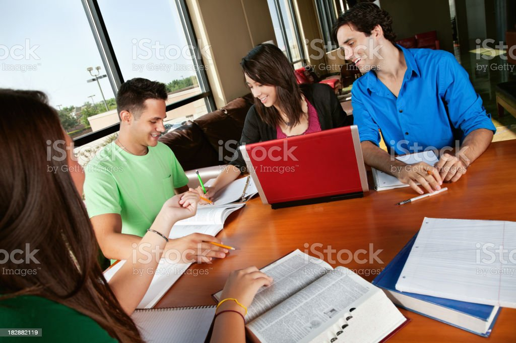 Group of College Students Studying Together in Library royalty-free stock photo