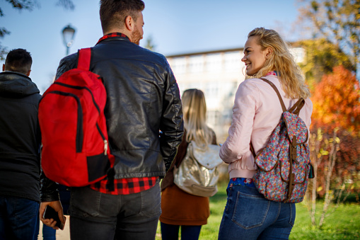 872670290 istock photo Group of college students walking on university campus 1019565878