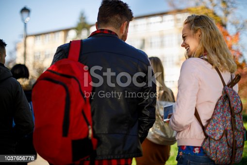 824257318 istock photo Group of college students walking on university campus 1037656778