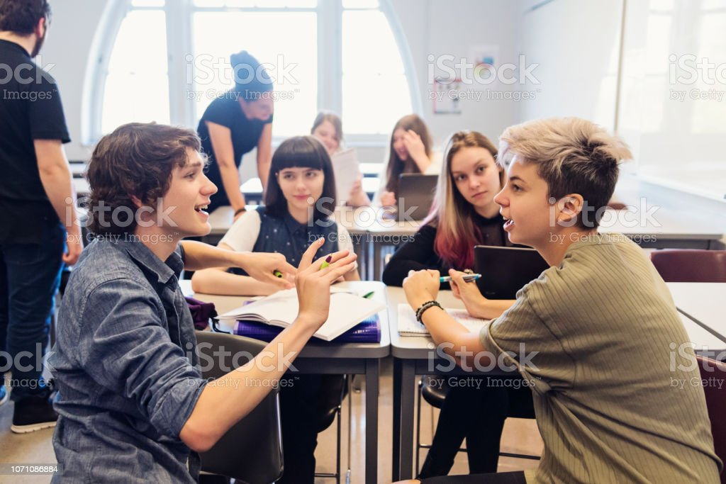 Group of College students working in team in classroom. stock photo