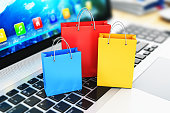 istock Group of color paper shopping bags on laptop keyboard 642901704