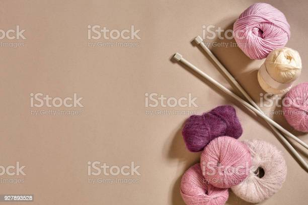 Group of colored balls of yarn and knitting needles on a beige picture id927893528?b=1&k=6&m=927893528&s=612x612&h=avby6i0thbtza38rpnqy7vnx5clmcd 89rzrzojjwfu=