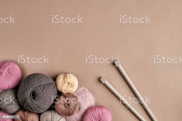 Group of colored balls of yarn and knitting needles on a beige picture id928006172?b=1&k=6&m=928006172&s=612x612&h=8jmqqv37x9urvsgyrpmycmq3z929puoprdgr7hd2wo4=