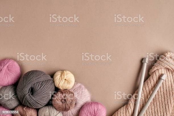 Group of colored balls of yarn and knitting needles on a beige picture id928009554?b=1&k=6&m=928009554&s=612x612&h=km7ikscjmnfas2atr6emz1racko5fqq4ad0fjervlqk=