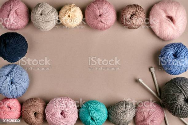 Group of colored balls of yarn and knitting needles on a beige picture id928036330?b=1&k=6&m=928036330&s=612x612&h=4d pqmrybhyz6db5ilq6eksz3zqmahy bbtifozw77g=