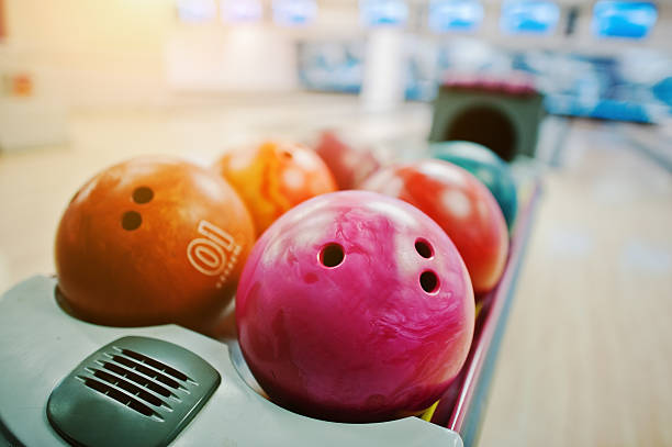 Group of colored bowling balls at bowl lift stock photo