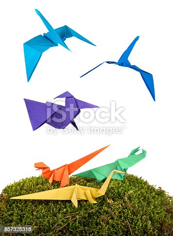 istock Group of colored origami paper dinosaurus 857325318