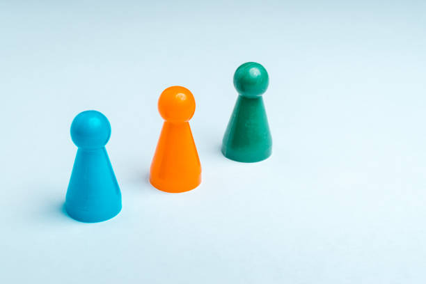 Group of colored pawns on a white background Group of colored pawns on a white background famiglia stock pictures, royalty-free photos & images