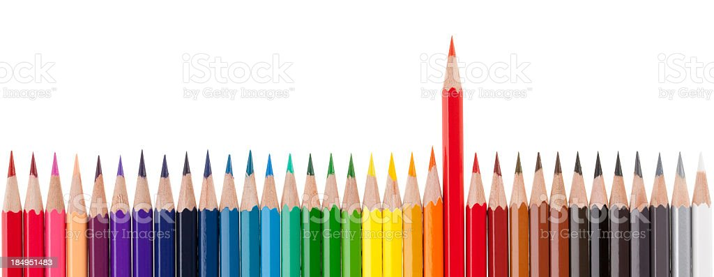 Group of colored pencils with one out from the crowd royalty-free stock photo