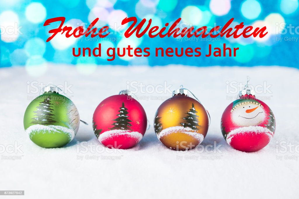 Frohe Weihnachten Und Ein.Group Of Colorful Christmas Balls With Text In German Frohe