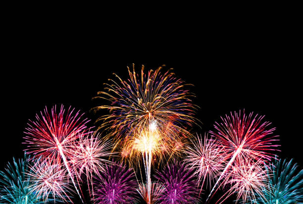group of colorful fireworks on dark background. - firework display stock pictures, royalty-free photos & images