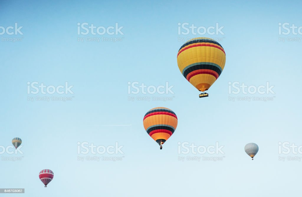 A group of colorful hot air balloons against stock photo