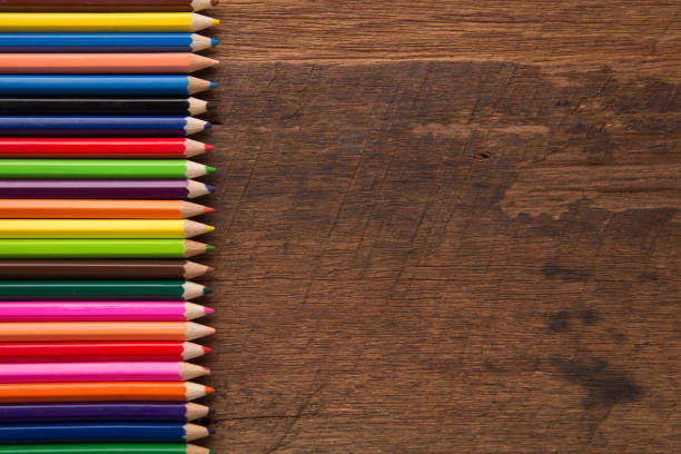 group of colorful pencils on the wood table  background artwork gallery equipment tool concept - coloured pencil stock photos and pictures