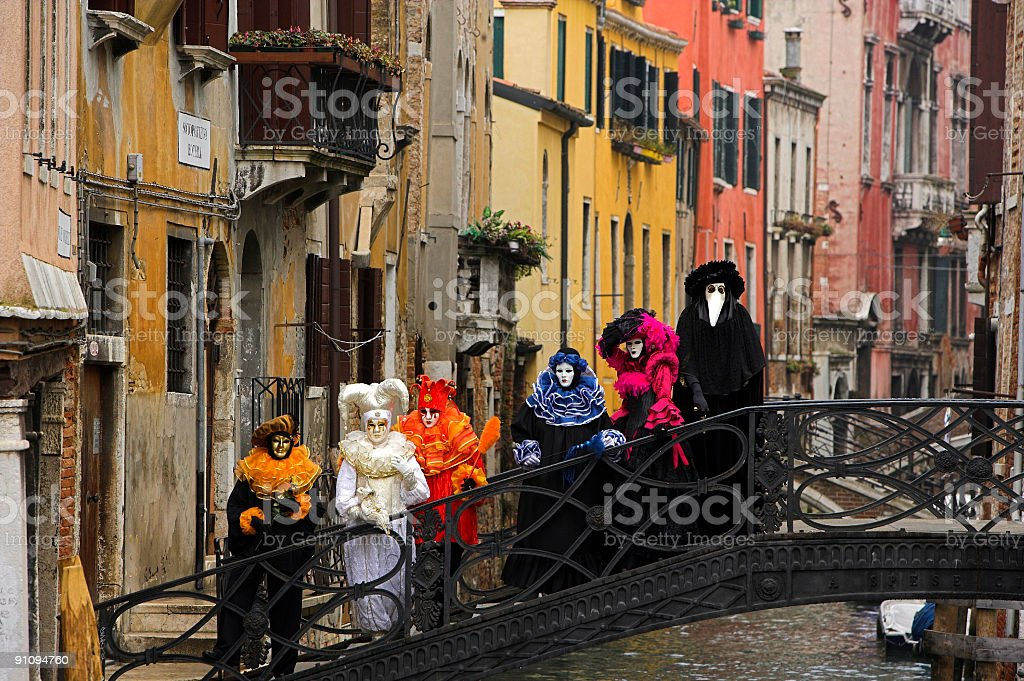 Group of colorful venetian masks on bridge in Venice stock photo