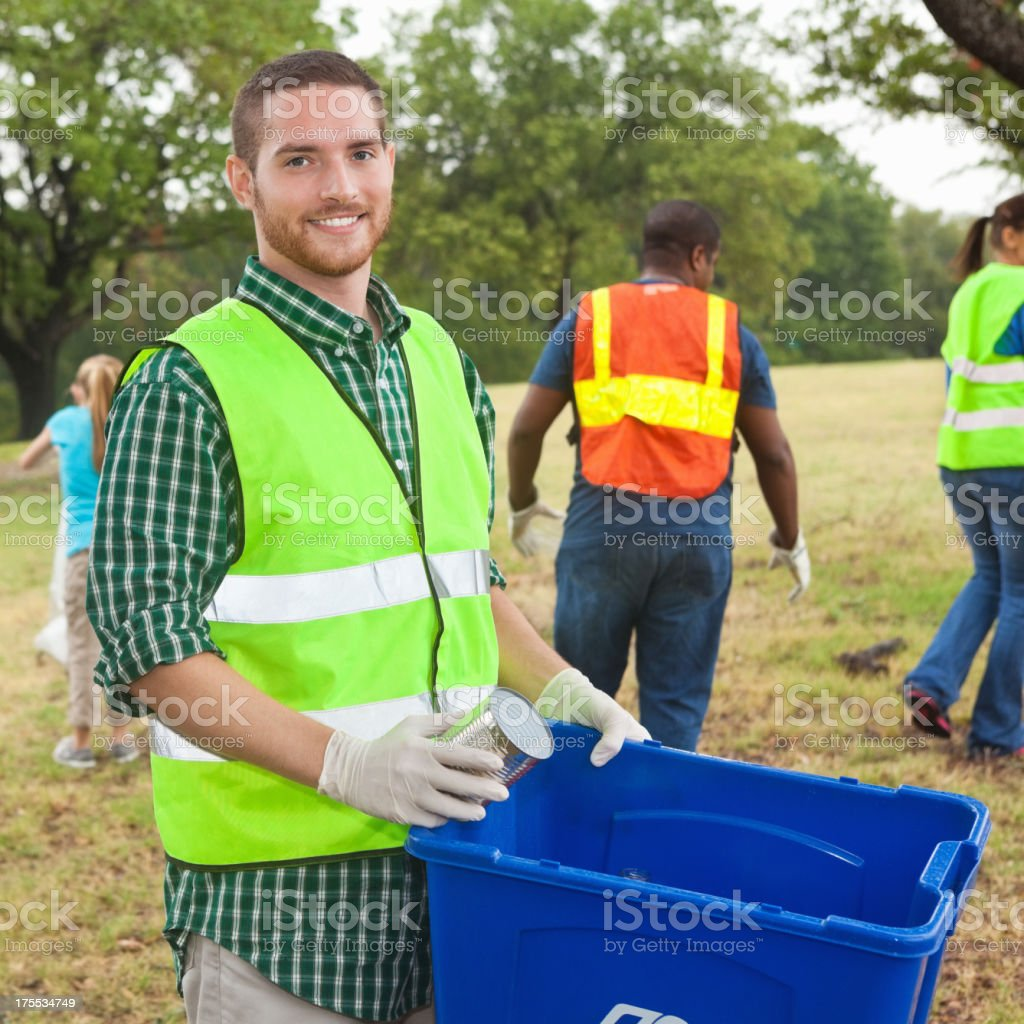 Group of community volunteers cleaning up trash in city park royalty-free stock photo