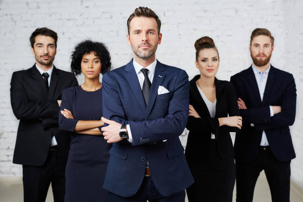 Group of confident, perky lawyers standing together stock photo