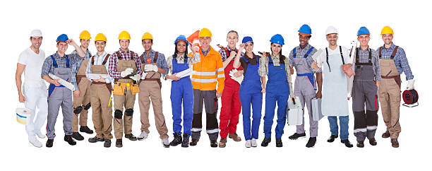 group of construction workers - protective workwear stock pictures, royalty-free photos & images