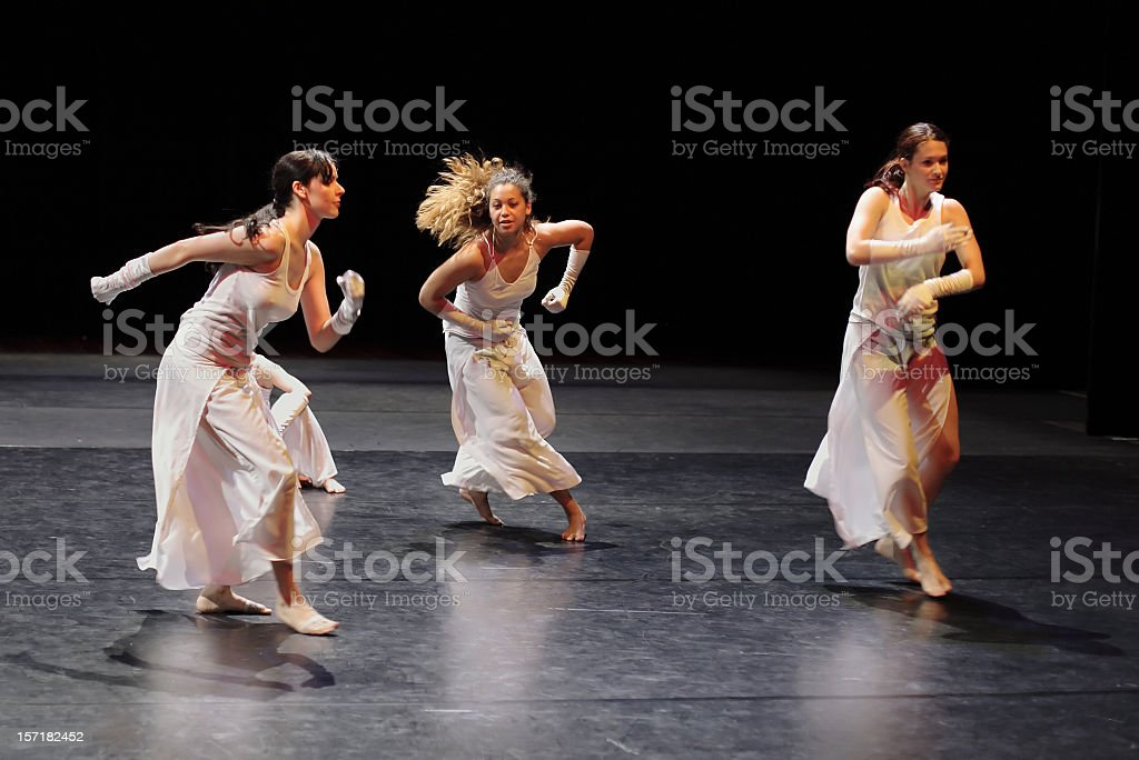 Group of contemporary dancers performing on stage. stock photo