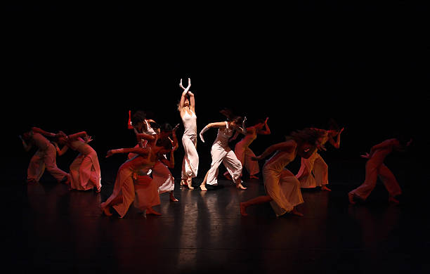 group of contemporary dancers performing on stage - performing arts event stock pictures, royalty-free photos & images