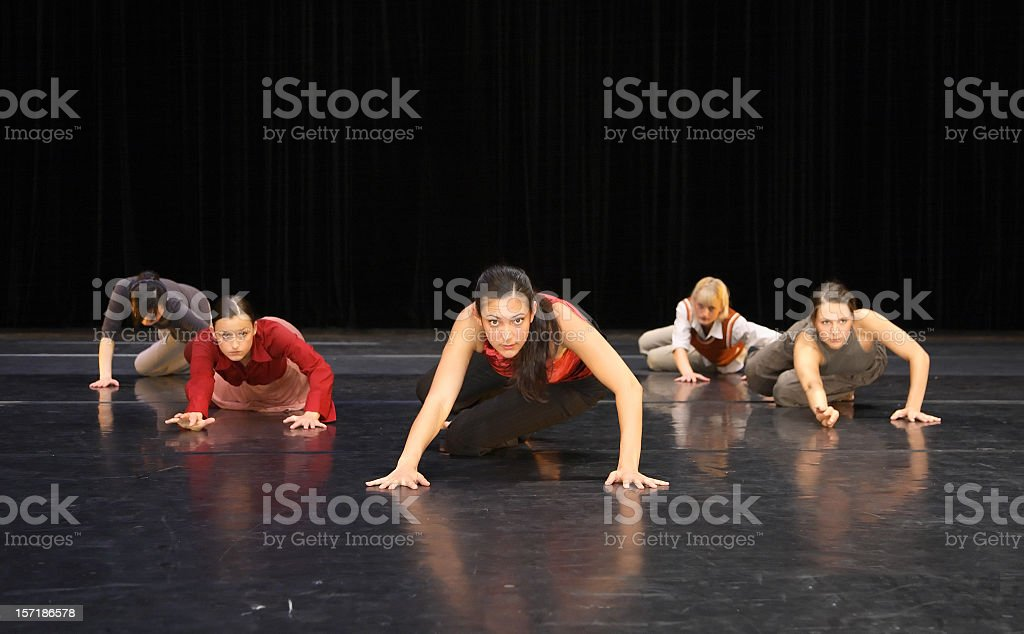 Group of contemporary dancers performing on stage royalty-free stock photo