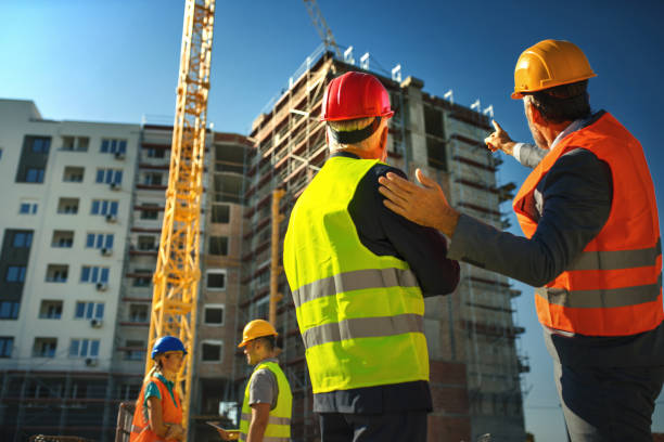 Group of contractors supervising building process stock photo
