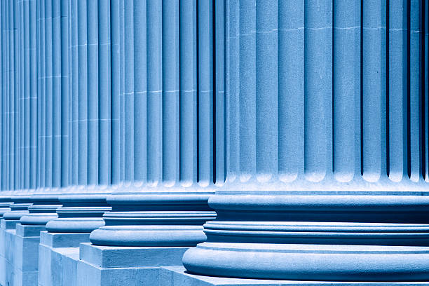 group of corporate blue business columns XXXL - wonderful columns in front of the new york city court house - blue filter treatment - shallow depth of field - focus at first column - camera canon 5D mark II - unsharped RAW - adobe colorspace neo classical stock pictures, royalty-free photos & images