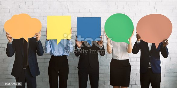 Business opinion concept. Group of corporate people hiding faces behind blank speech bubbles, empty space