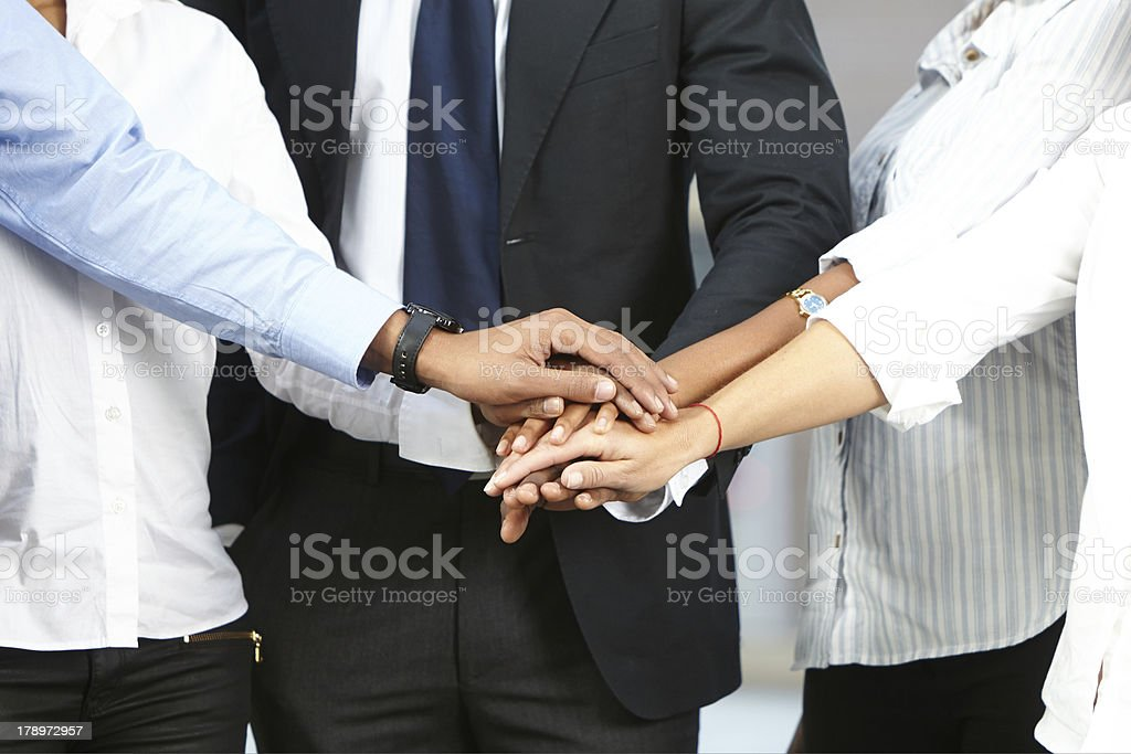 Group of corporates with hands together stock photo