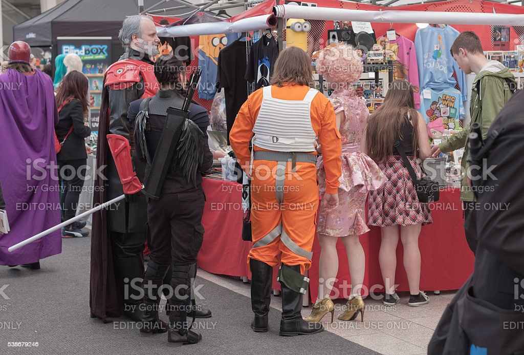 Group of cosplayers showing  products at market stock photo