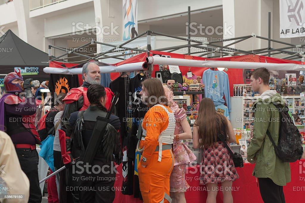 Group of cosplayers talking near market stock photo