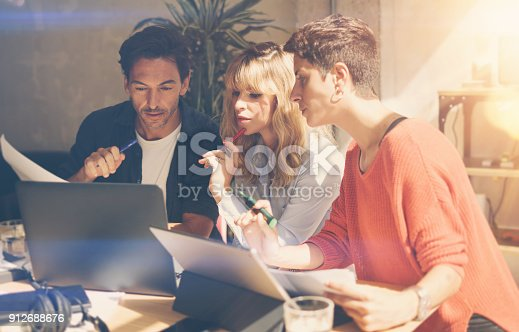 912675036 istock photo Group of coworkers making great conversation during work process in modern office.Business people meeting concept.Blurred background.Horizontal. 912688676