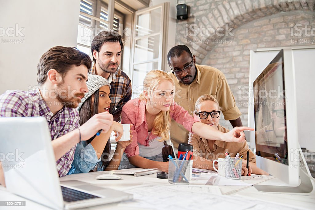 Group of coworkers working together stock photo