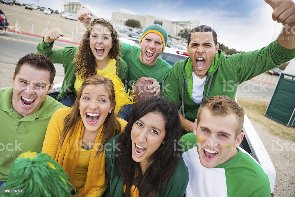 Group of crazy fans at college football stadium tailgate party stock photo
