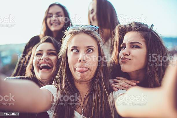 Group of crazy girls taking selfie and making faces outdoors picture id626724070?b=1&k=6&m=626724070&s=612x612&h=dovuav4ao h9o oop4d0dmovy0kbkdmziefxdev os0=