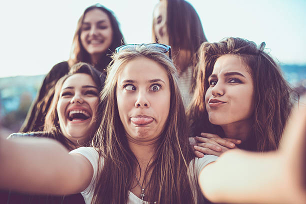 group of crazy girls taking selfie and making faces outdoors - bisarr bildbanksfoton och bilder