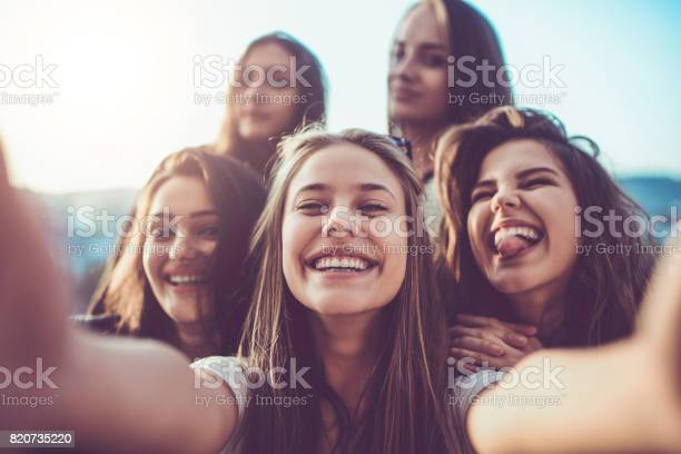 Group of crazy girls taking selfie and making faces outdoors picture id820735220?b=1&k=6&m=820735220&s=612x612&h=fd ipxzzhnymkadcdltvfkuj4h wkqlm9x49kw8qfrw=
