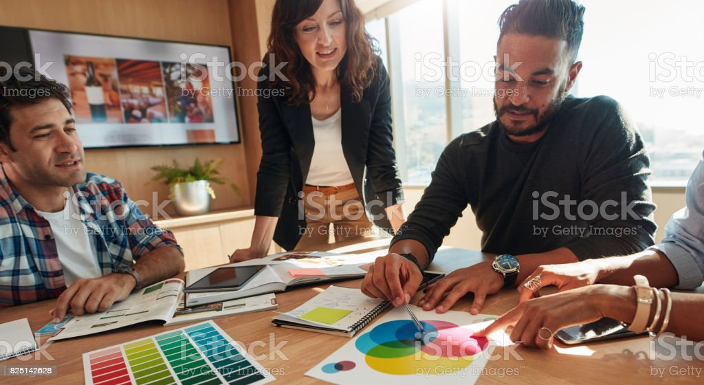 Group of creative designers discuss the color palette stock photo