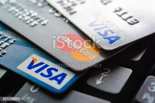 Bangkok, Thailand - Jun 23, 2015 : Group of credit cards on computer keyboard with VISA and MasterCard brand logos