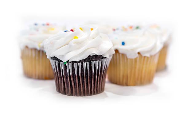 group of cupcakes on a white background - vanille muffins stock-fotos und bilder