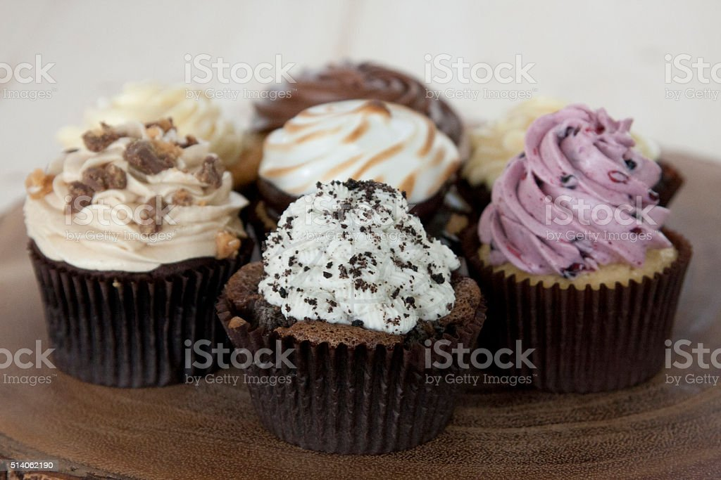 Group of Cupcakes on wood stock photo