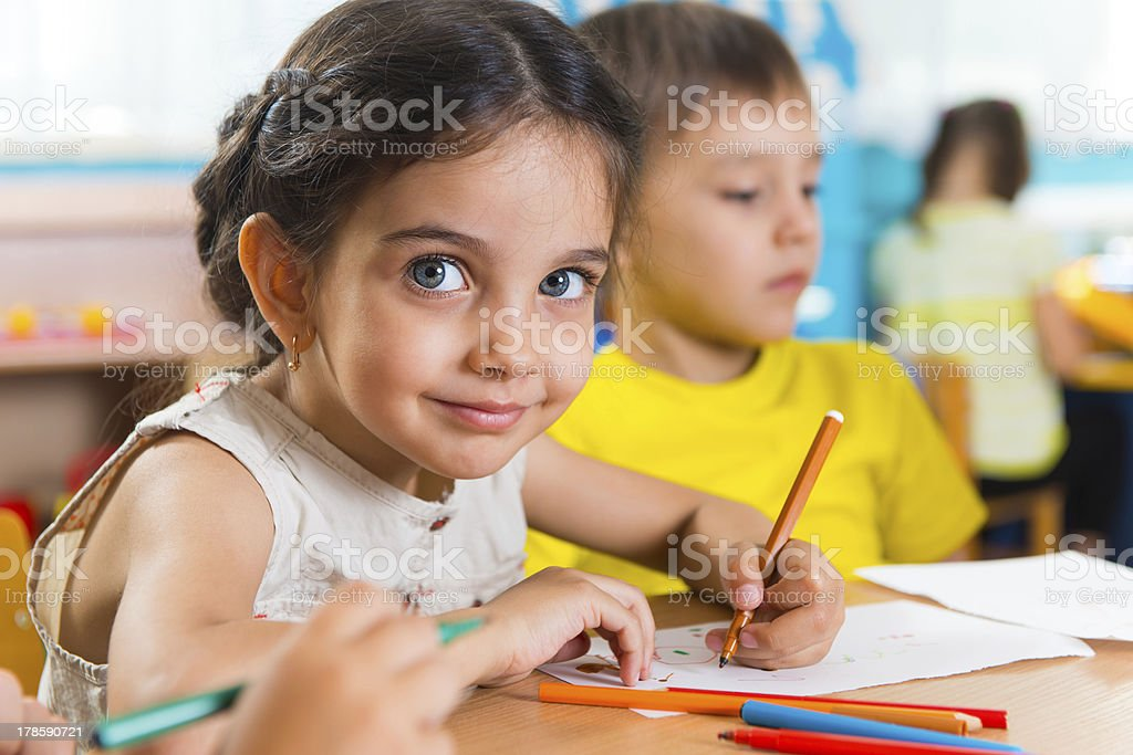 Group of cute little prescool kids drawing royalty-free stock photo